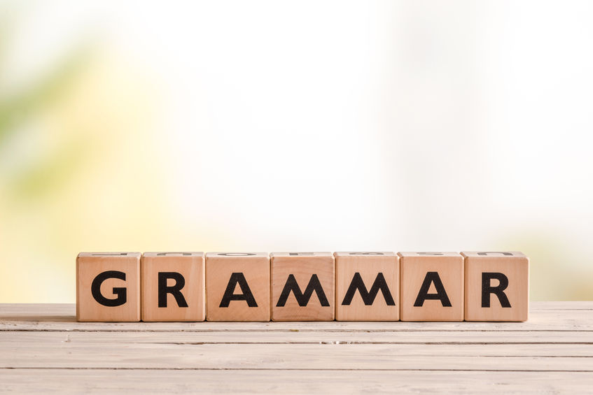 This is a picture of the word grammar spelled with wooden blocks.
