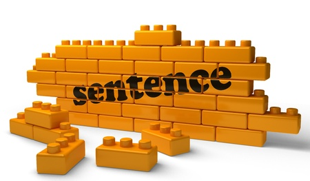 "This is a graphic of an orange wall made of large lego bricks. Across the wall the word ""sentence"" is written."